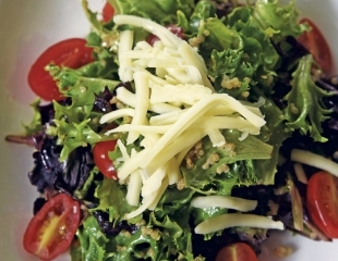 Mixed greens salad with white cheddar and balsamic vinaigrette