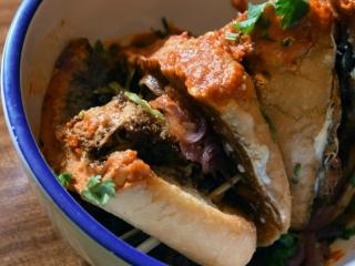 El Taco Luchador's Carnitas torta with a guajillo dipping sauce