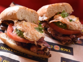 El Taco Luchador's Torta with bacon, Mexican chorizo, smoked ham, tomato and fried egg
