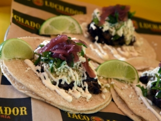 El Taco Luchador's Pork tacos with pickled onions, tomatillo and crema