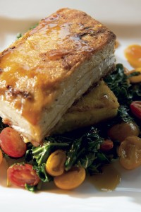 Crispy pork bell with braised greens