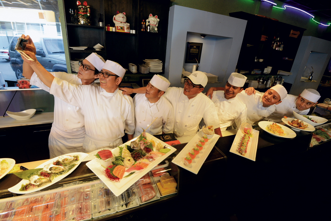 Sapporo's gang of Sushi Chefs pose for a selfie.