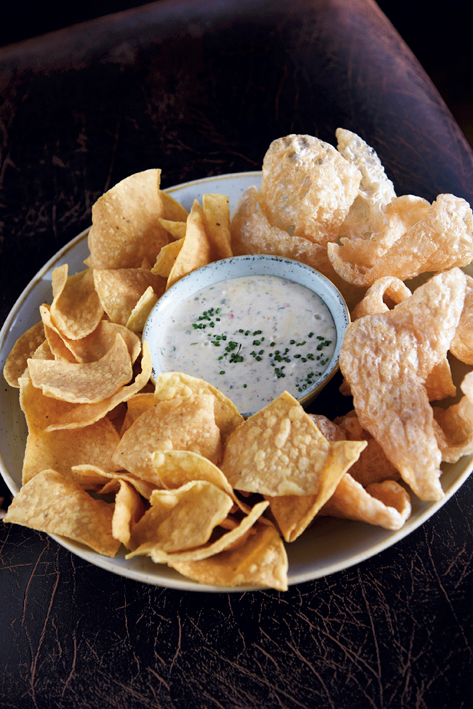 "In homage to the lontime previous occupant, KTs ""famous"" spinach queso is on the menu, but with a Le Moo twist — pork rinds"