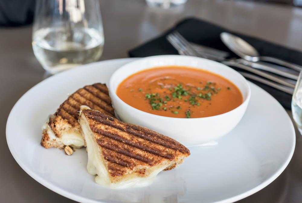Grilled Gruyere and Taleggio cheese sandwich with tomato bisque
