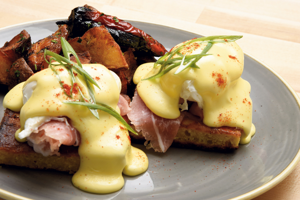 Farmhouse benedict: pork belly and poached eggs over cornbread with hollandaise