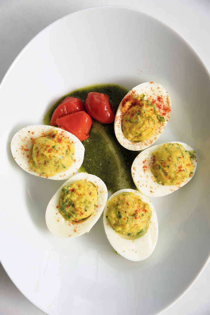 Deviled eggs with Butcher's spice, chimichurri, black pepper aioli and peppadew garnish