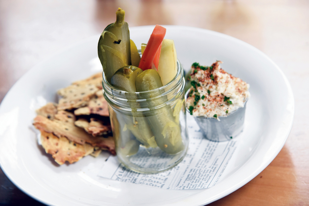 Bourbon Barrel pickles with smoked onion dip and flax seed cracker