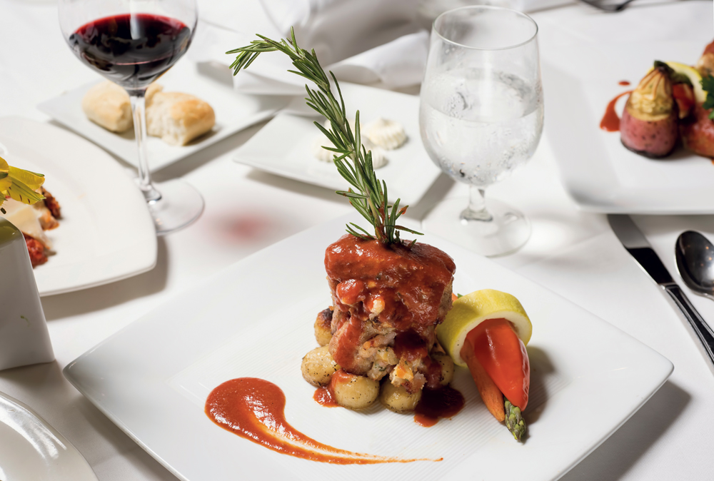 Filetto di vitello al madeira - medallion of veal stuffed with smoked Gouda and pancetta in a Madeira wine sauce.