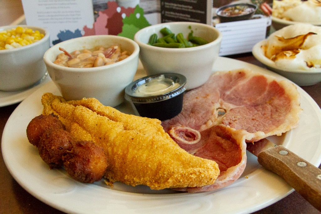 Fried catfish, hushpuppies, country ham, green beans, white beans with ham hock, sweet corn, and banana bread pudding.